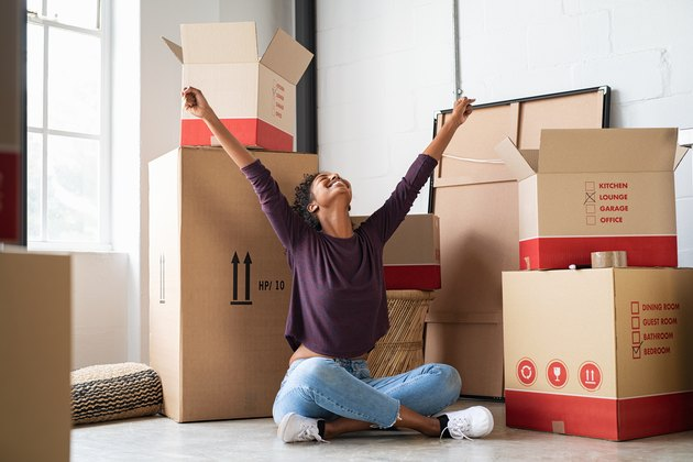 Excited young woman in new apartment