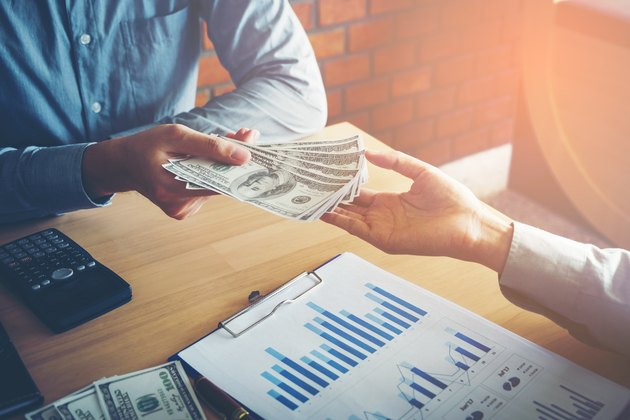 Hand giving money United States Dollars bills ,Hand receiving money from businessman
