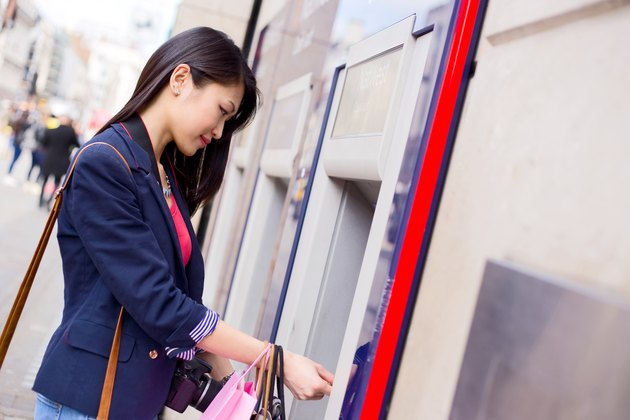 How to Use a Credit Card at an ATM             girl at ATM