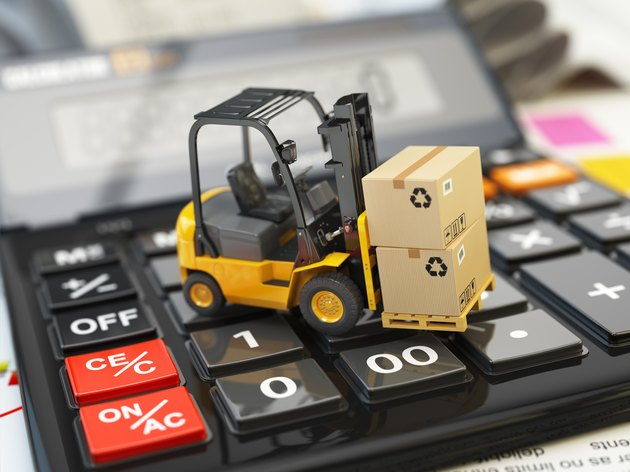 Difference Between GST & VAT                 Forklift with cardboxes on calculator. Calculation of shipping d