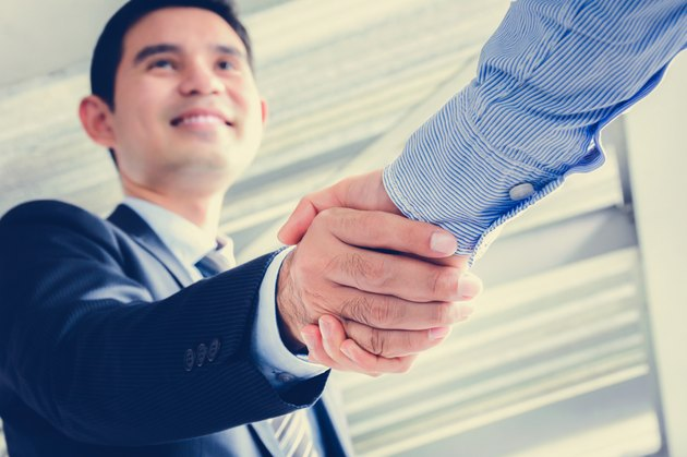 What Is a Non-Mandatory or Reorganization Tender Stock Offer?Businessmen making handshake
