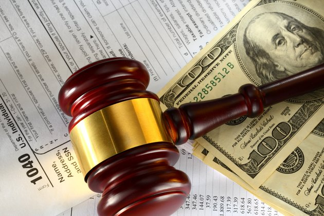 Do You Have to Pay Taxes on Lawsuit Settlements?Budget, tax form, gavel and dollars