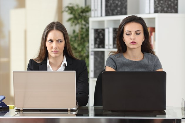 Angry businesswomen looking with hate