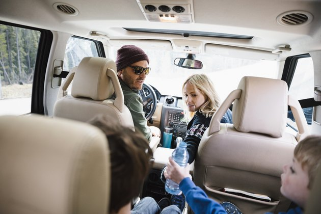 Family on road trip, riding in SUV