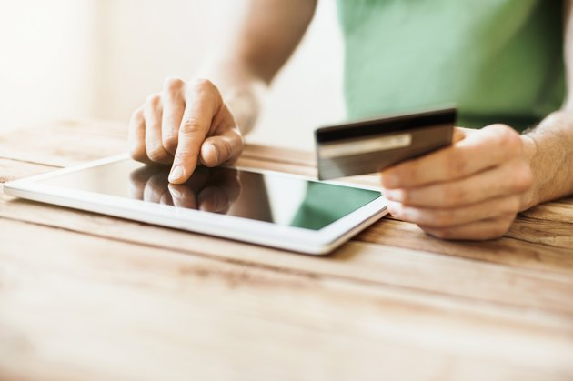 How to Enter a Credit Card Number                Man is shopping online