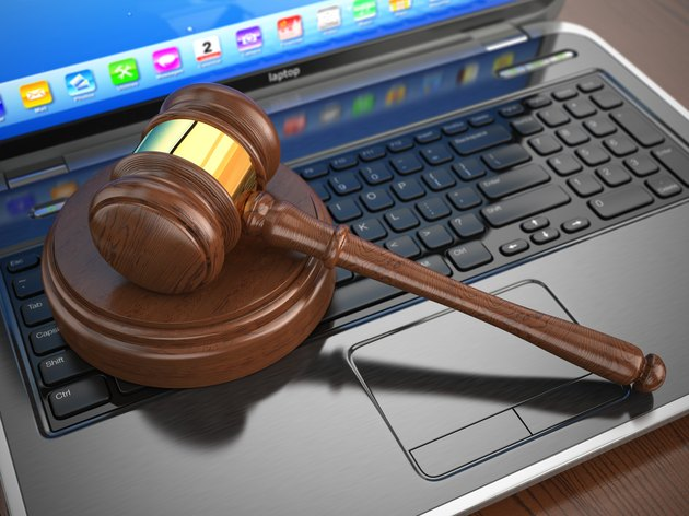 How To Check a Bankruptcy Status OnlineOnline internet auction. Gavel on laptop.