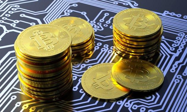 Bitcoin virtual currency on a circuit board
