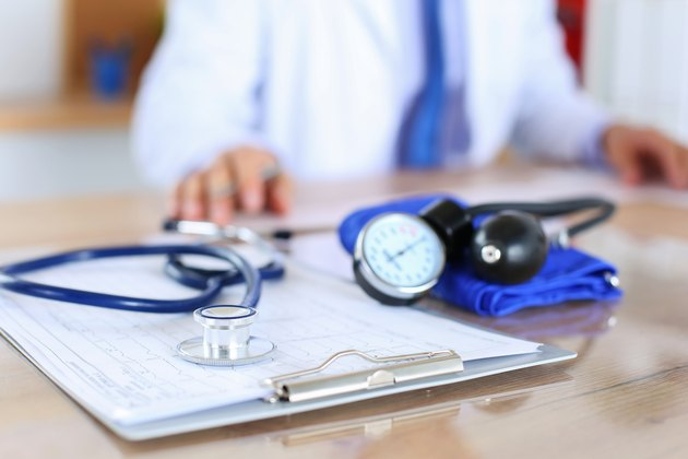 Definition of Supplemental Insurance       Medical stethoscope lying on cardiogram chart closeup