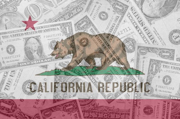 Can I Collect Social Security & CalPERS Together?US state of california flag with transparent dollar banknotes