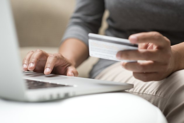 How Do I Retrieve Old Credit Card Statements?Close up of hands shopping online