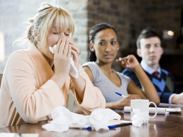 woman sick at work