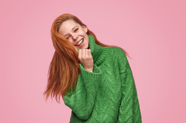 Adorable happy woman in stylish sweater