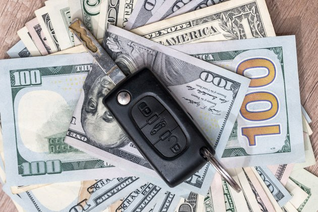 Can I Get My Car Downpayment Back?          car key on dollar bills