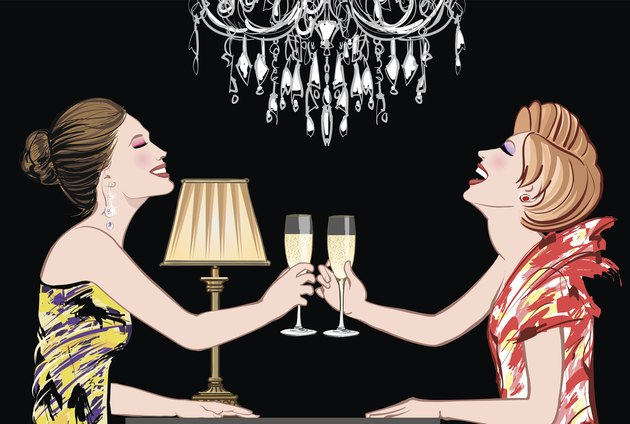 Two young happy women with champagne glasses