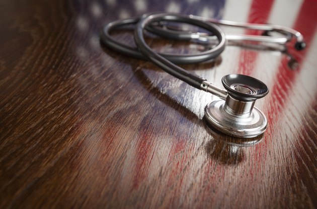 Medicaid Eligibility Information                Stethoscope with American Flag Reflection on Table