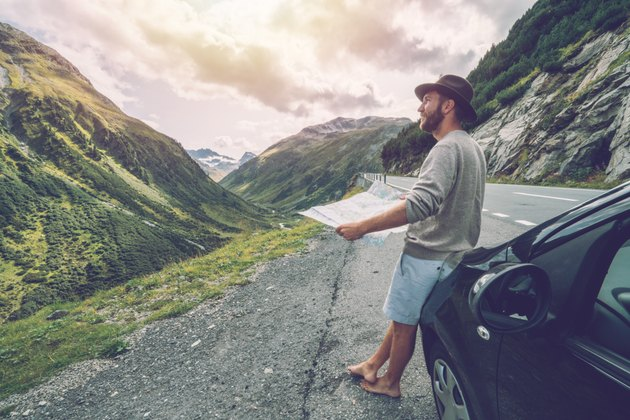 Young man traveling in Switzerland, road trip