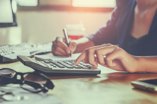 businessman working on desk office using calculator business financial accounting concept