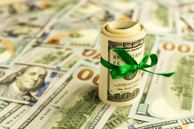 How to Ask Rich People for Money               Stack of money with a ribbon. Expensive gift