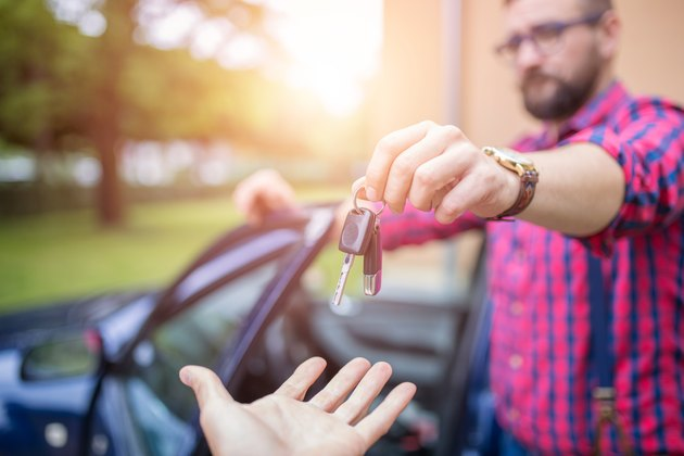 What Happens After Voluntary Repossession on a Vehicle?Giving back car keys
