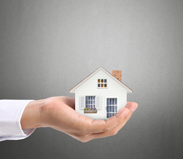 Who Is the Grantor in a Mortgage?              holding house representing home ownership