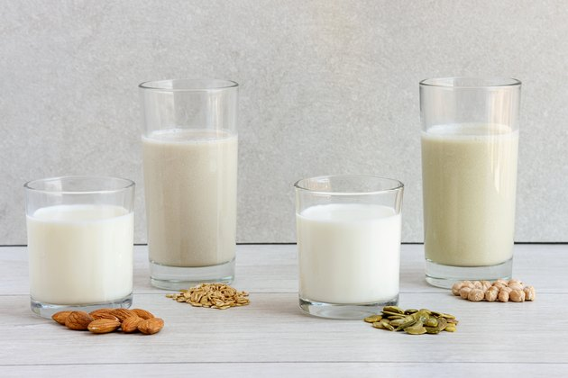 Various vega non dairy milk from nuts, seeds, cereals and legumes