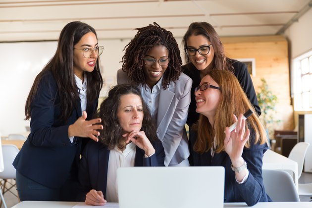 Front view of cheerful businesswomen talking during work