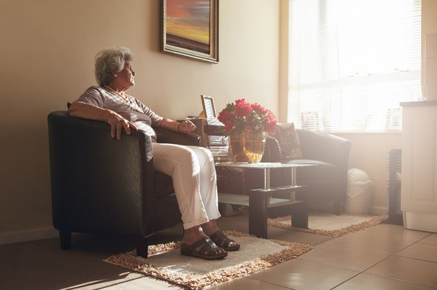 How to Find the Cheapest Places to RetireSenior woman sitting alone on a chair at home