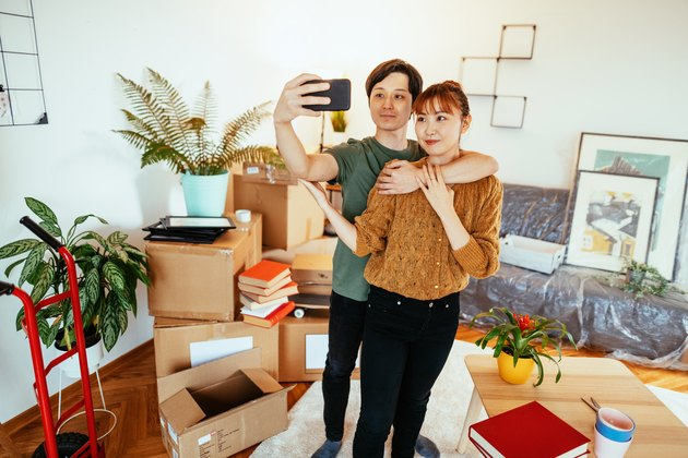 Japanese couple moving out and taking selfie before leaving