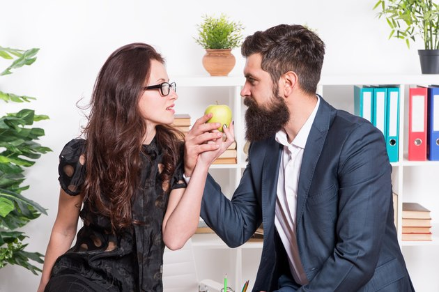 Couple coworkers relax lunch break. Share lunch with with colleague. Flirting colleagues. Bearded man and attractive woman. Man and woman conversation during lunch time. Office rumors. Office lunch