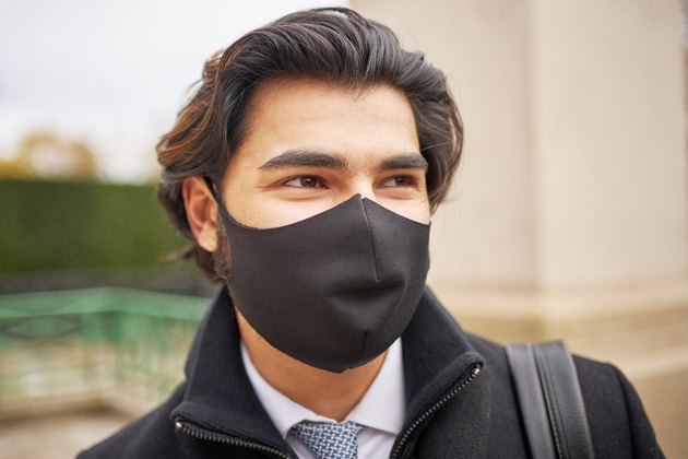A portrait of a smart young man wearing a protective face mask