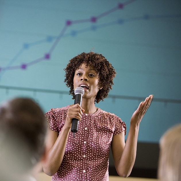 Woman asking a question at an informational meeting