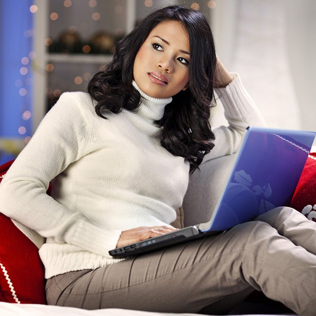 Woman working on taxes at computer