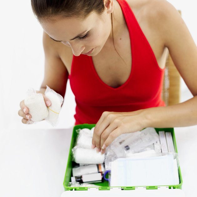 woman looking through a first aid kit