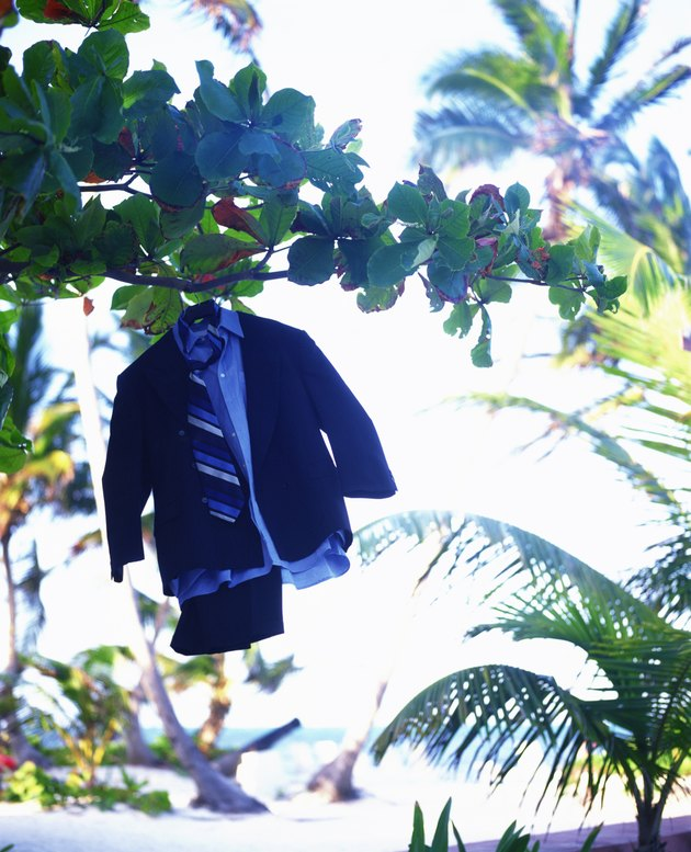 Three piece suit hanging in tropical trees