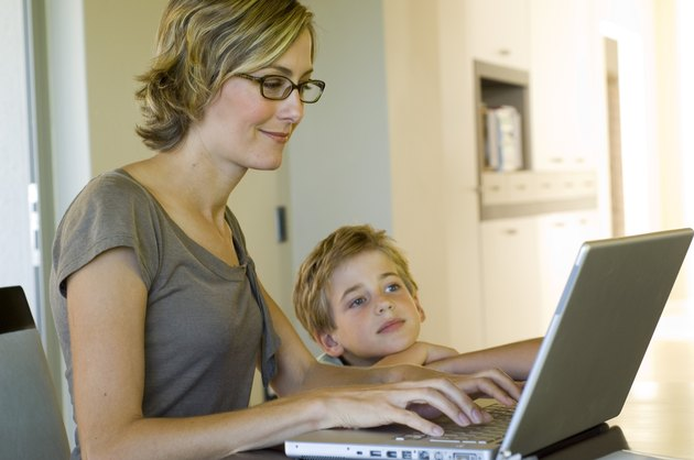 Woman and boy using laptop computer