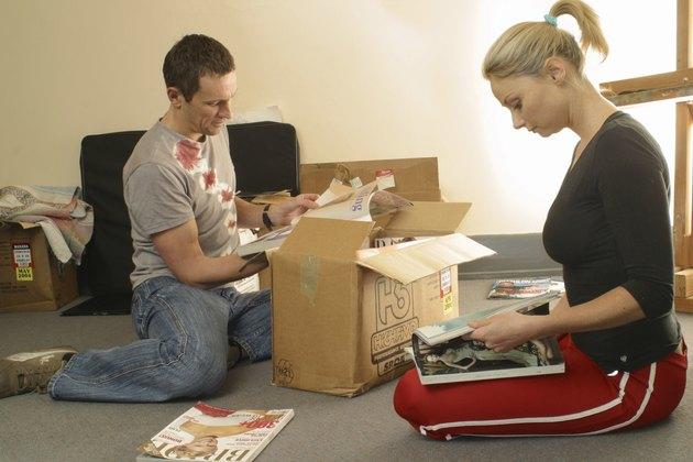 A couple unpacking a box, Melbourne Australia.
