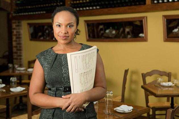 Portrait of female restaurant owner