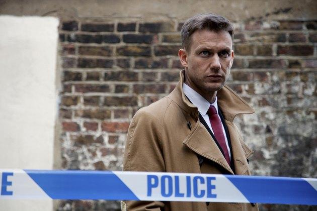 Portrait of a male police detective at crime scene