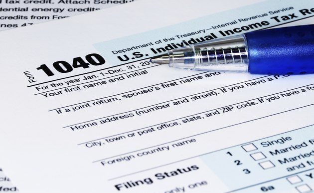 Tax Return Form with a Pen