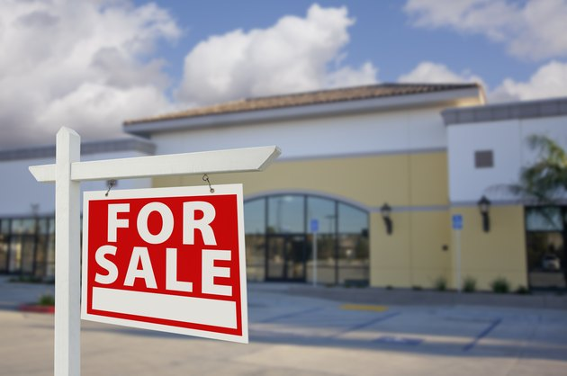 Vacant Retail Building with For Sale Real Estate Sign