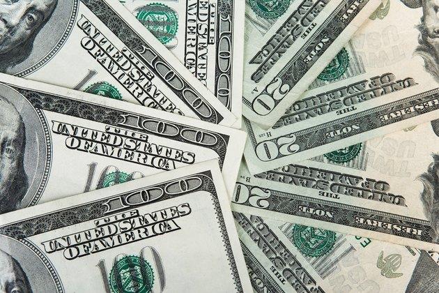 Close-up of one hundred and twenty dollar bills
