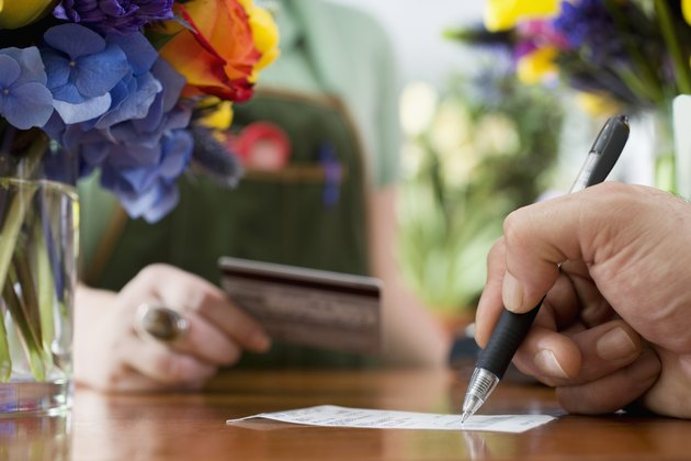Man Signing Receipt for Flowers