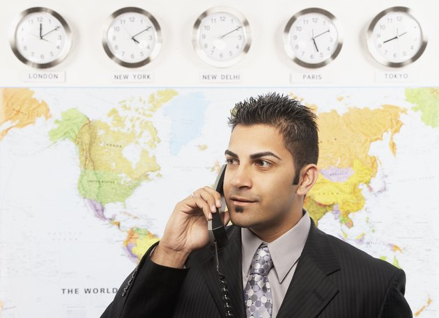 Indian businessman talking on telephone