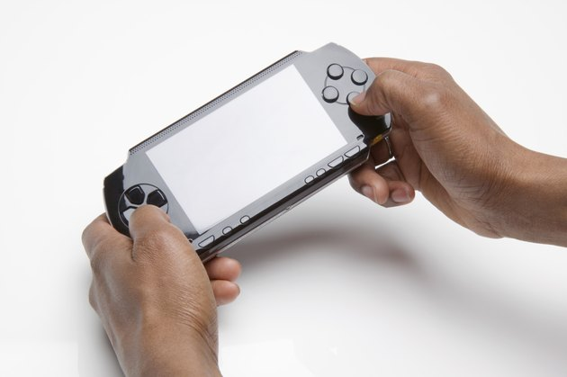 Hands holding portable video game