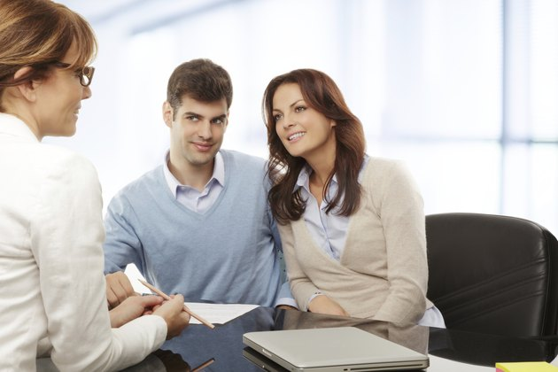 Young couple discussing financial plan with consultat