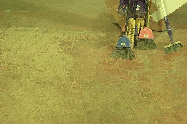 Brooms on concrete floor