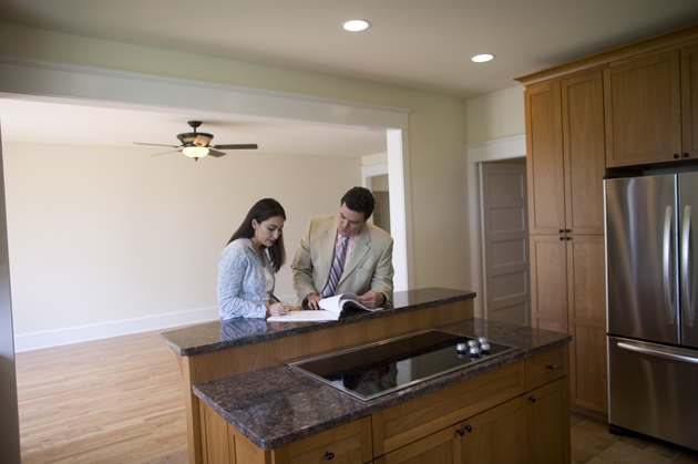 Woman and realtor signing contract to new home