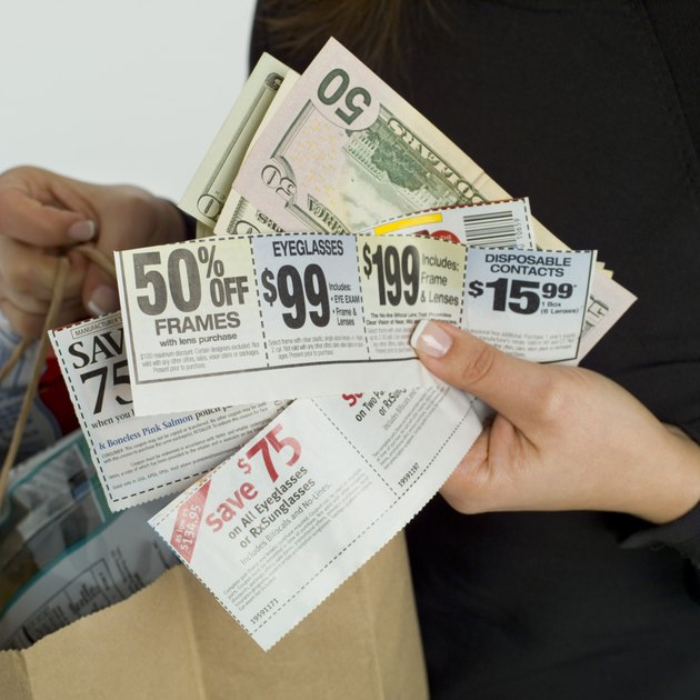 Woman with coupons, money and groceries