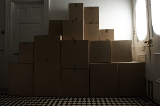 stacked packing boxes in hallway
