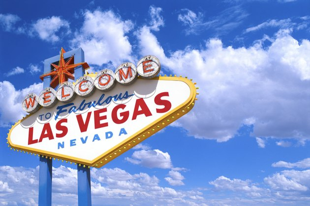 The ?Welcome to Fabulous Las Vegas Nevada' sign against a blue sky with fluffy white clouds